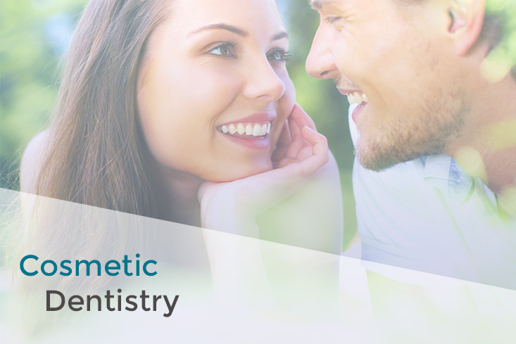 Two people with straight, white teeth looking at each other